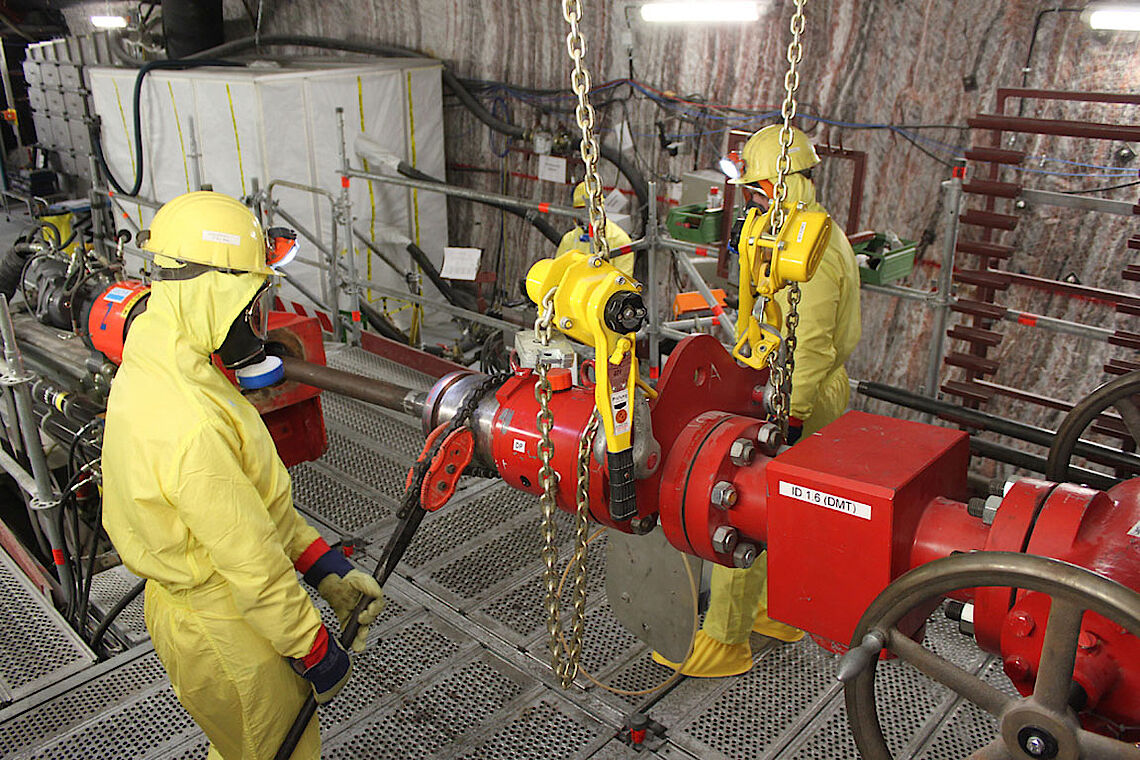 Closing the rotary blow-out preventer in full protective clothing