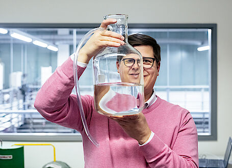 Antti Pasanen, PhD, EurGeol, Team Manager, Geological Survey of Finland (GTK) with a water sample in the laboratory